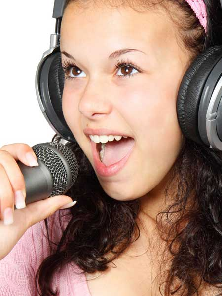 Girl Singing with Mic and Headphones